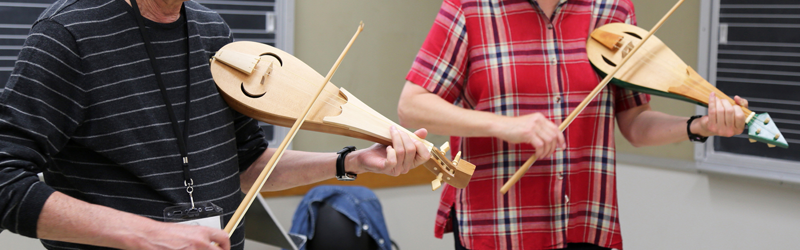 Two participants play early music instruments during a workshop at MEMF 2015
