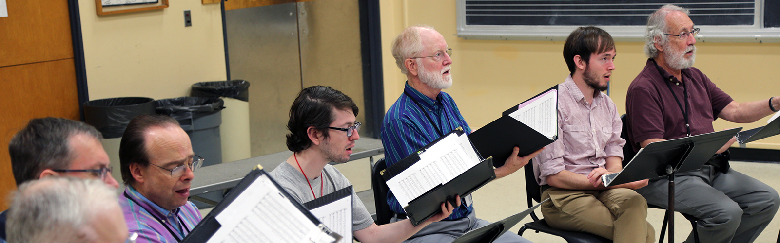 A group of male singers practice at a MEMF 2016 workshop